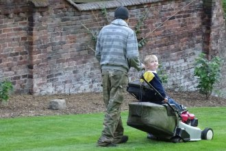 Nat and his son preparing to mow