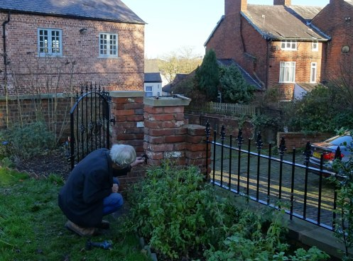 Nick fixing the gate